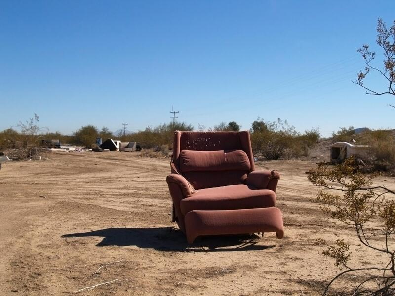 a sofa in a middle of nowhere