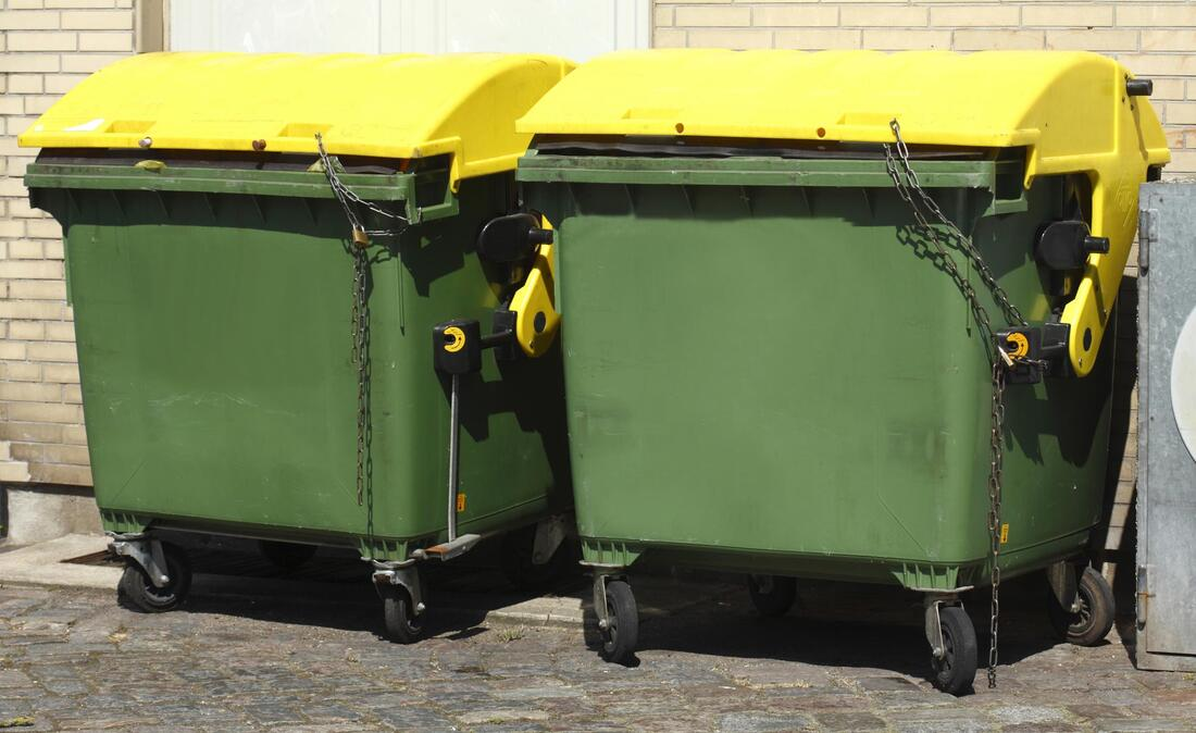 two green dumpster bins